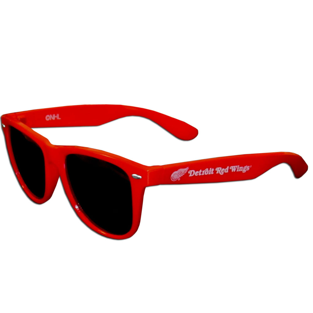 Detroit Red Wings® Beachfarer Sunglasses - Our beachfarer sunglass feature the Detroit Red Wings® logo and name silk screened on the arm of these great retro glasses. 400 UVA protection.