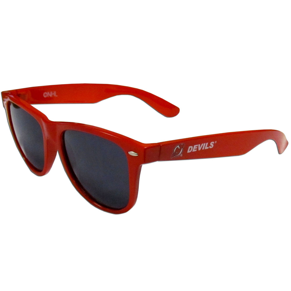 New Jersey Devils® Beachfarer Sunglasses - Our beachfarer sunglass feature the New Jersey Devils® logo and name silk screened on the arm of these great retro glasses. 400 UVA protection.