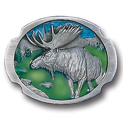 "Moose Antiqued Belt Buckle - ""This belt buckle features a moose standing by a lake.  This exquisitely carved buckle is made of fully cast metal with a standard bale that fits up to 2"""" belts.  Buckle is enhanced with two shades of green and blue enamel."""