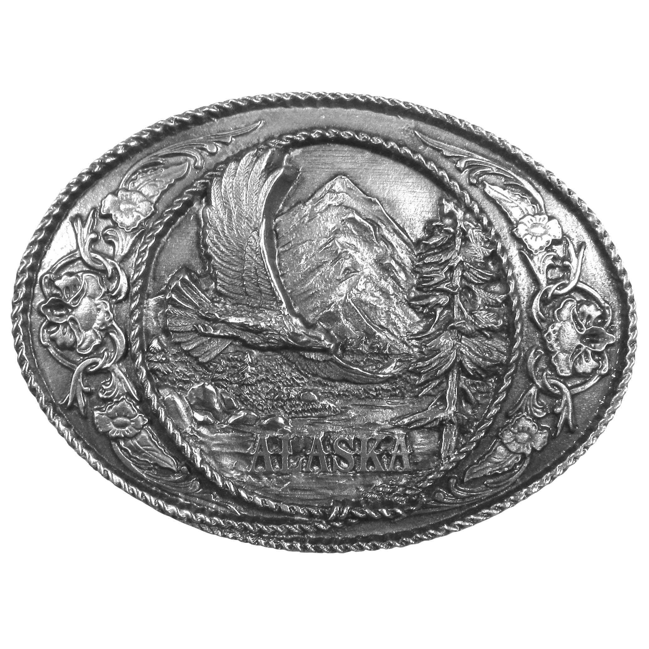 "Alaska Eagle Antiqued Belt Buckle - ""A beautifully designed image of a bald eagle and the word """"Alaska"""" is centered on this buckle with flowers, trees, mountains and rivers.  The design is surrounded by a rope on this exquisitely carved buckle made of fully cast metal.  The standard bale fits up to 2"""" belts."""