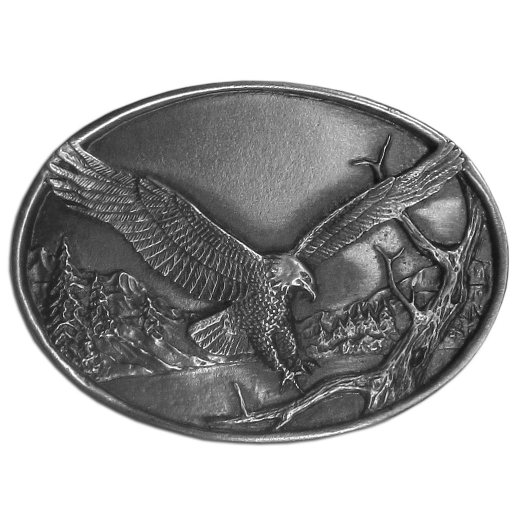 "Small Eagle Antiqued Belt Buckle - ""This buckle features an eagle with outstretched wings landing with a beautiful mountain lake background.  This petite buckle is 2-1/2"""" x 1-3/4"""".  This exquisitely carved buckle is made of fully cast metal with a standard bale that fits up to 2"""" belts."""