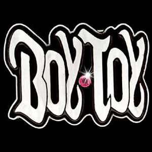 "Graffiti Expressions Buckle - Boy Toy - Are you a Boy Toy?  Wear it loudly and proudly with our Graffiti Expressions buckle, a Siskiyou Gifts exclusive.  Enameled in vibrant color and featuring a rhinestone, buckle measures 3 1/2"" x 2 1/2""."