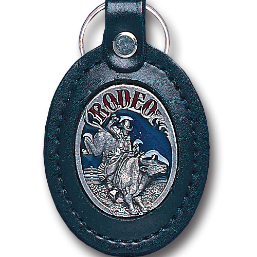 Lg Leather Key Chain - Rodeo - This Rodeo key fob combines fine leather surrounding a sculpted & enameled emblem. The intricate design and craftsmanship makes this key ring a unique and long lasting gift.