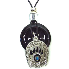 "Onyx and Diamond Cut Necklace - Bear Paw - Onyx colored circle with diamond cut pendant on a 24"" adjustable leather cord. Check out our entire line of  jewelry."