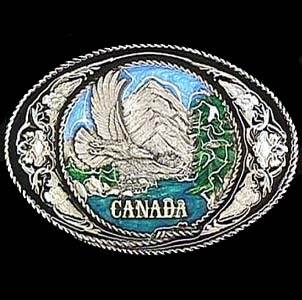 Belt Buckle - Canada with Western Scroll - This finely sculpted and enameled belt buckle contains exceptional 3D detailing. Siskiyou's unique buckle designs often become collector's items and are unequaled with the best in craftsmanship.