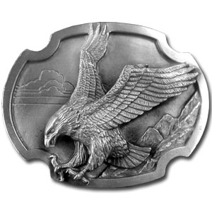 "Eagle Landing Antiqued Belt Buckle - ""This beautiful buckle features an eagle with its claws outstretched as if catching prey.  In the background are mountains and sky.  This exquisitely carved buckle is made of fully cast metal with a standard bale that fits up to 2"""" belts.  Siskiyou's unique buckle designs often become collectors items and are unequaled with the best craftsmanship. """