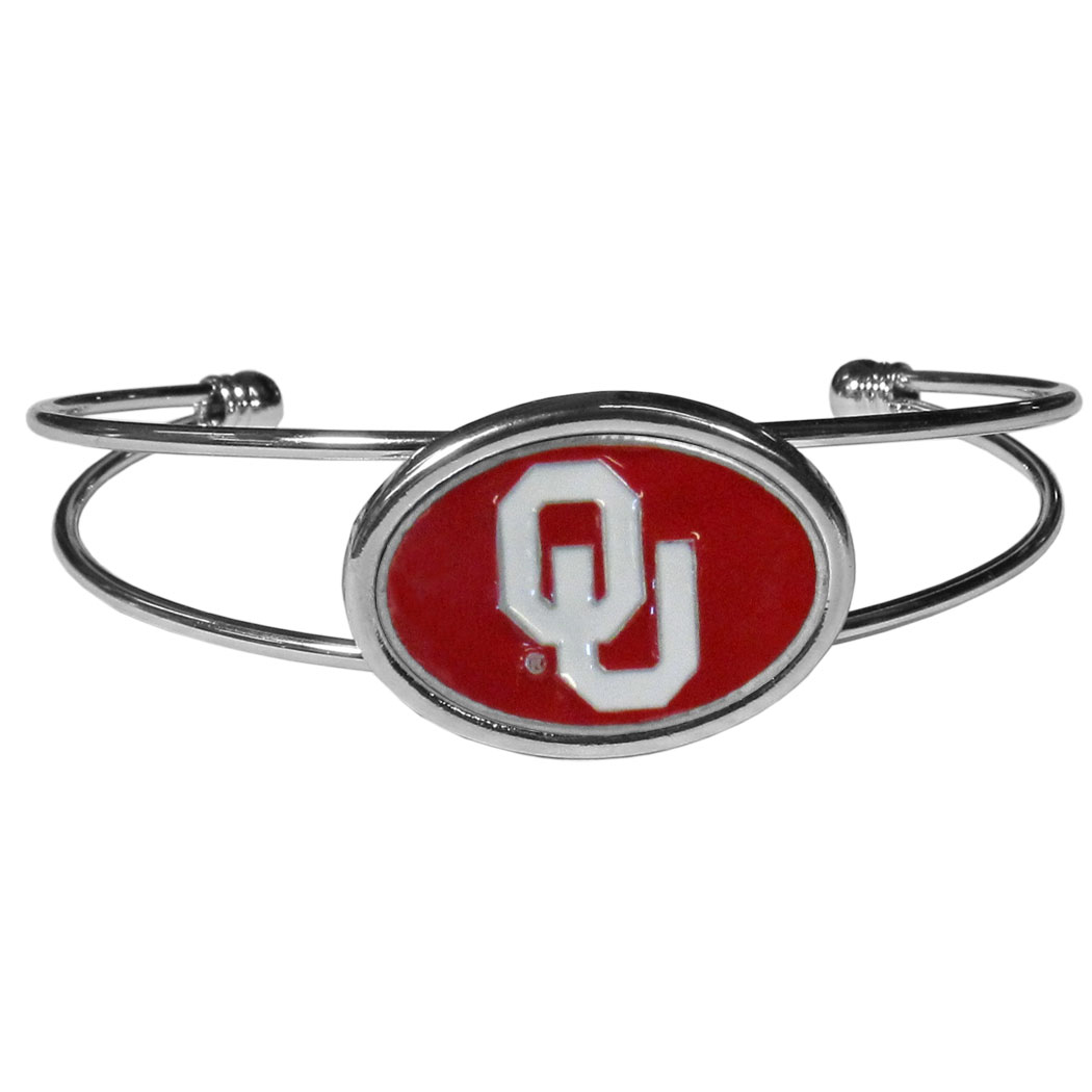 Oklahoma Sooners Cuff Bracelet - These comfortable and fashionable double-bar cuff bracelets feature a 1 inch metal Oklahoma Sooners inset logo with enameled detail.