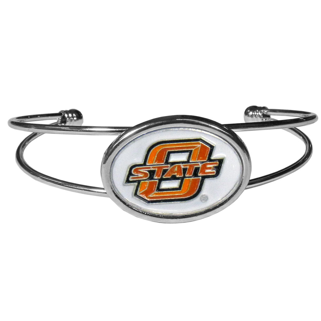 Oklahoma St. Cowboys Cuff Bracelet - These comfortable and fashionable double-bar cuff bracelets feature a 1 inch metal Oklahoma St. Cowboys inset logo with enameled detail.